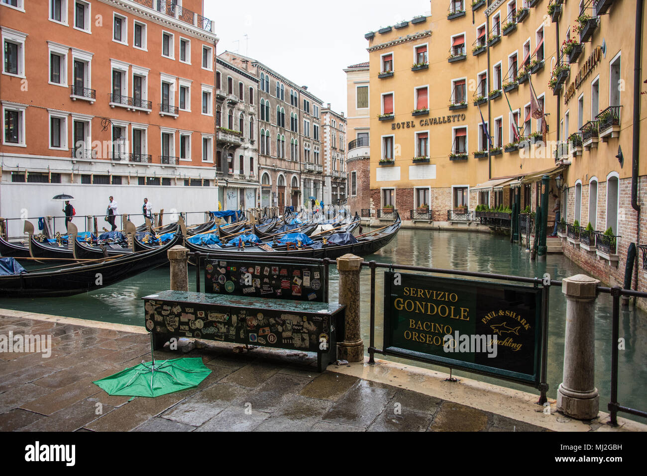 Gondolas moored in Bacino Orseolo in front of the  Hotel Cavalletto, Venice - Stock Image