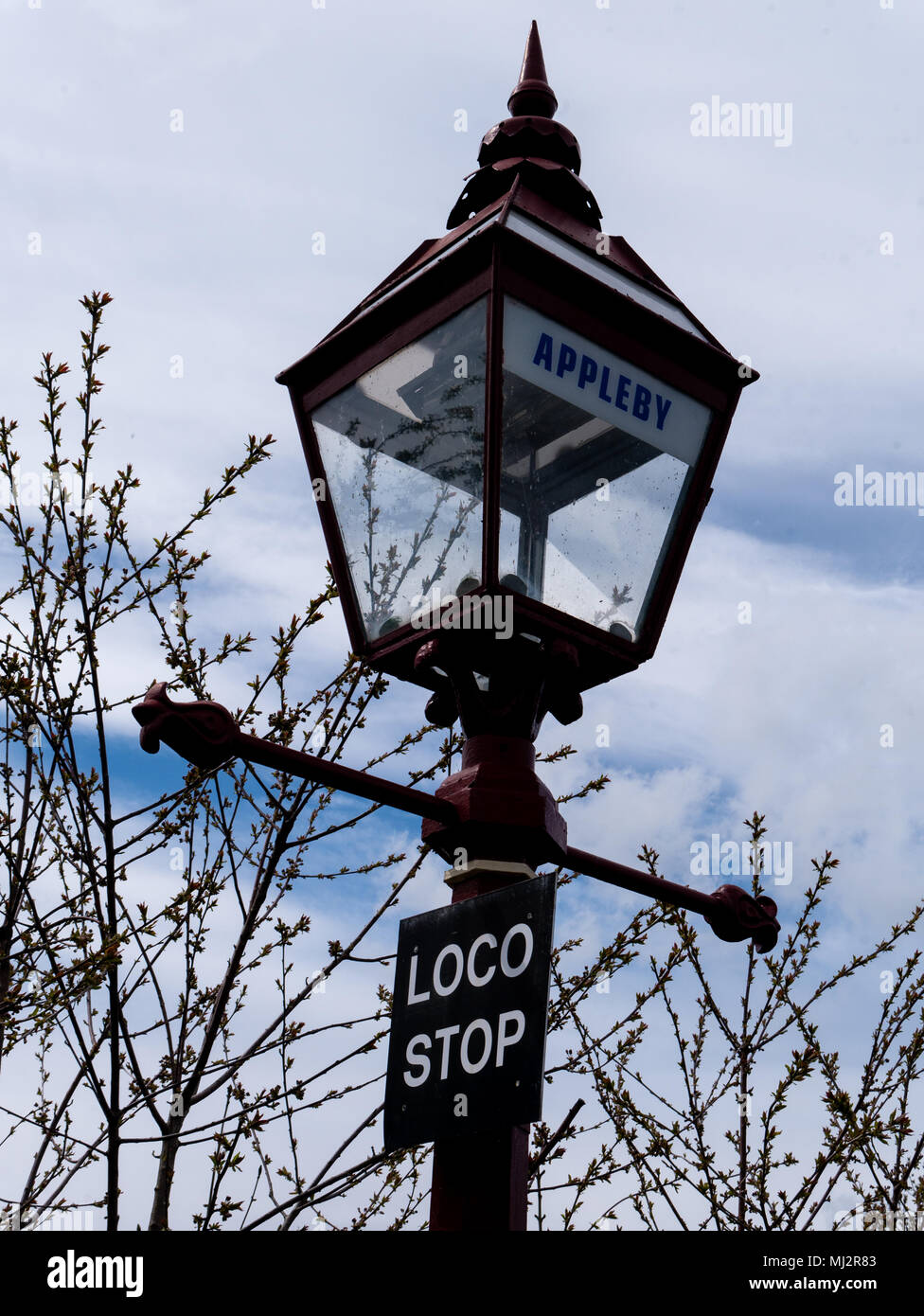 Old gas lamp on the plaform of Appleby railway station, Cumbria, UK - Stock Image