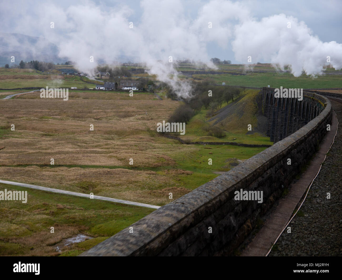 Steam train, The Dalesman, 48151, Carnforth to Carlisle West Coast line crossing the Ribblehead viaduct, North Yorkshire - Stock Image