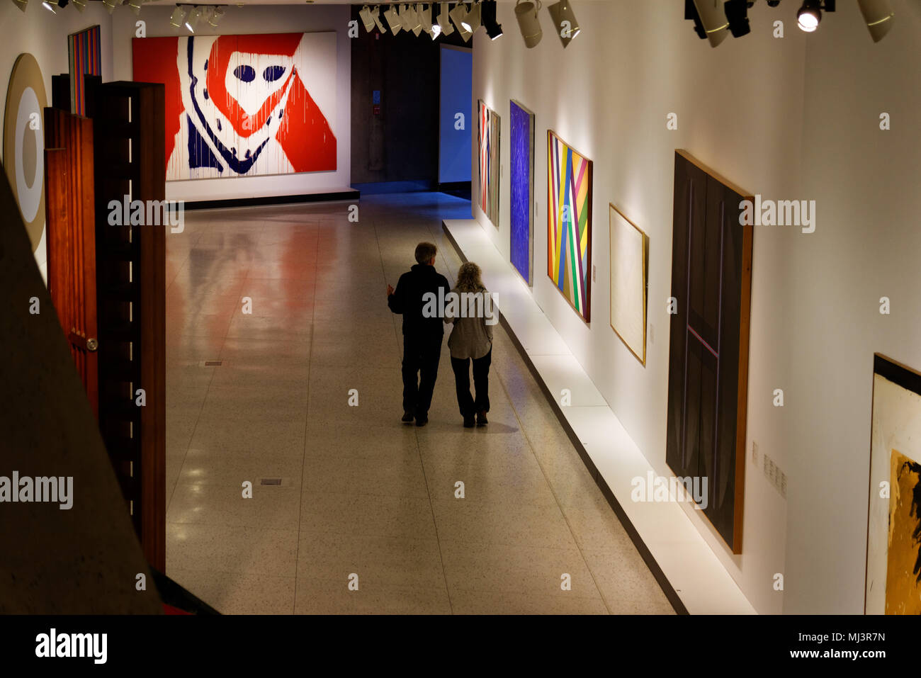Two people inside the Pavillon Claire et Marc Bourgie in the Montreal Fine Arts Museum - Stock Image