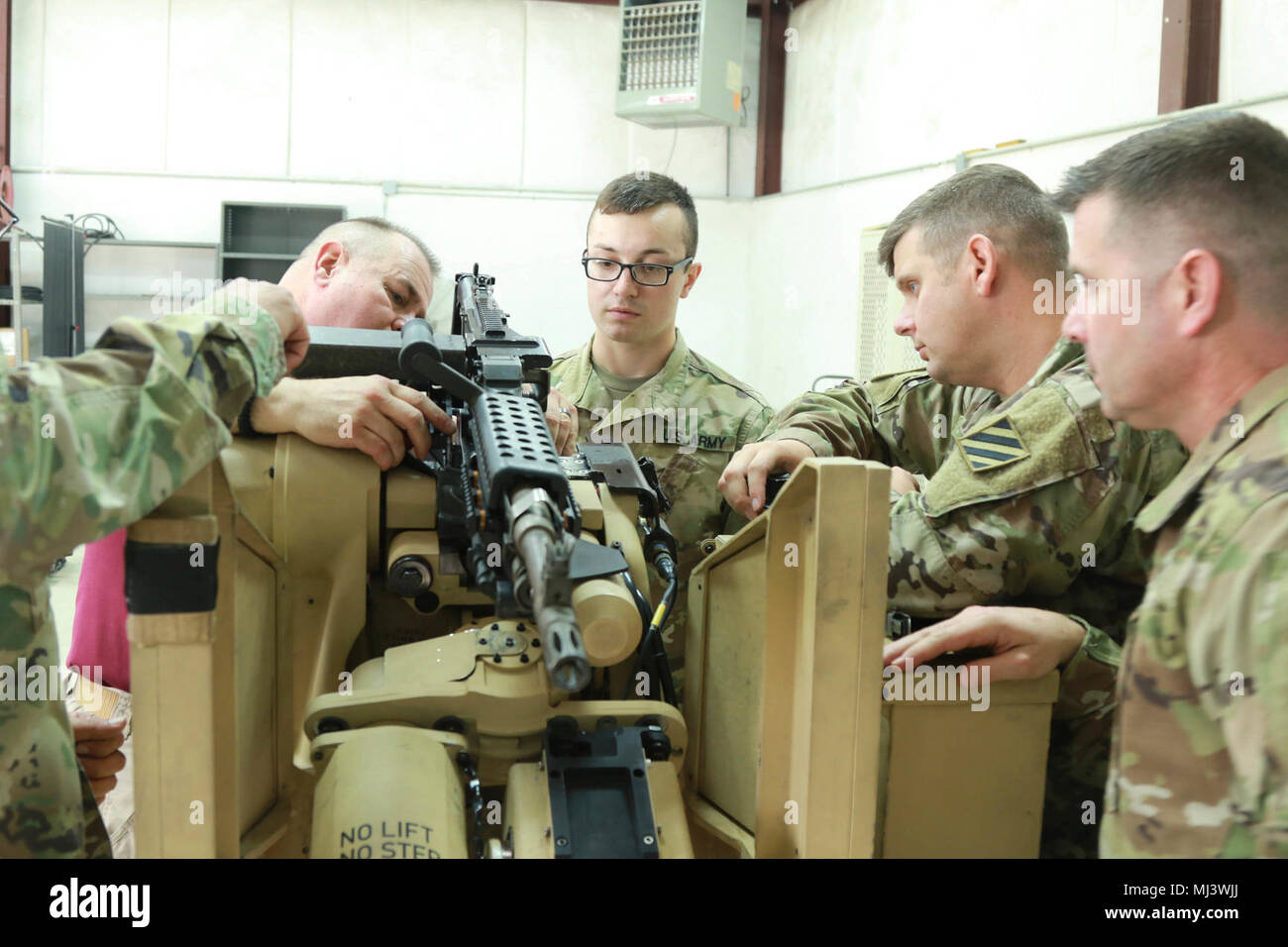 Fort Stewart, Ga., March 20, 2018 - Georgia Army National Gaurdsman Spc. Brandon C. Schultz, military policement, 179th Military Police Company, Fort, Stewart, Ga., briefs the performance steps to a group of Soldiers during the CROWS Instructors training course.  The Common Remotely Operated Weapon Station is an externally mounted weapons control system that allows the gunner to remain inside the vehicle while firing various crew served weapons.  (Georgia Army National Guard Image collection celebrating the bravery dedication commitment and sacrifice of U.S. Armed Forces and civilian personnel Stock Photo