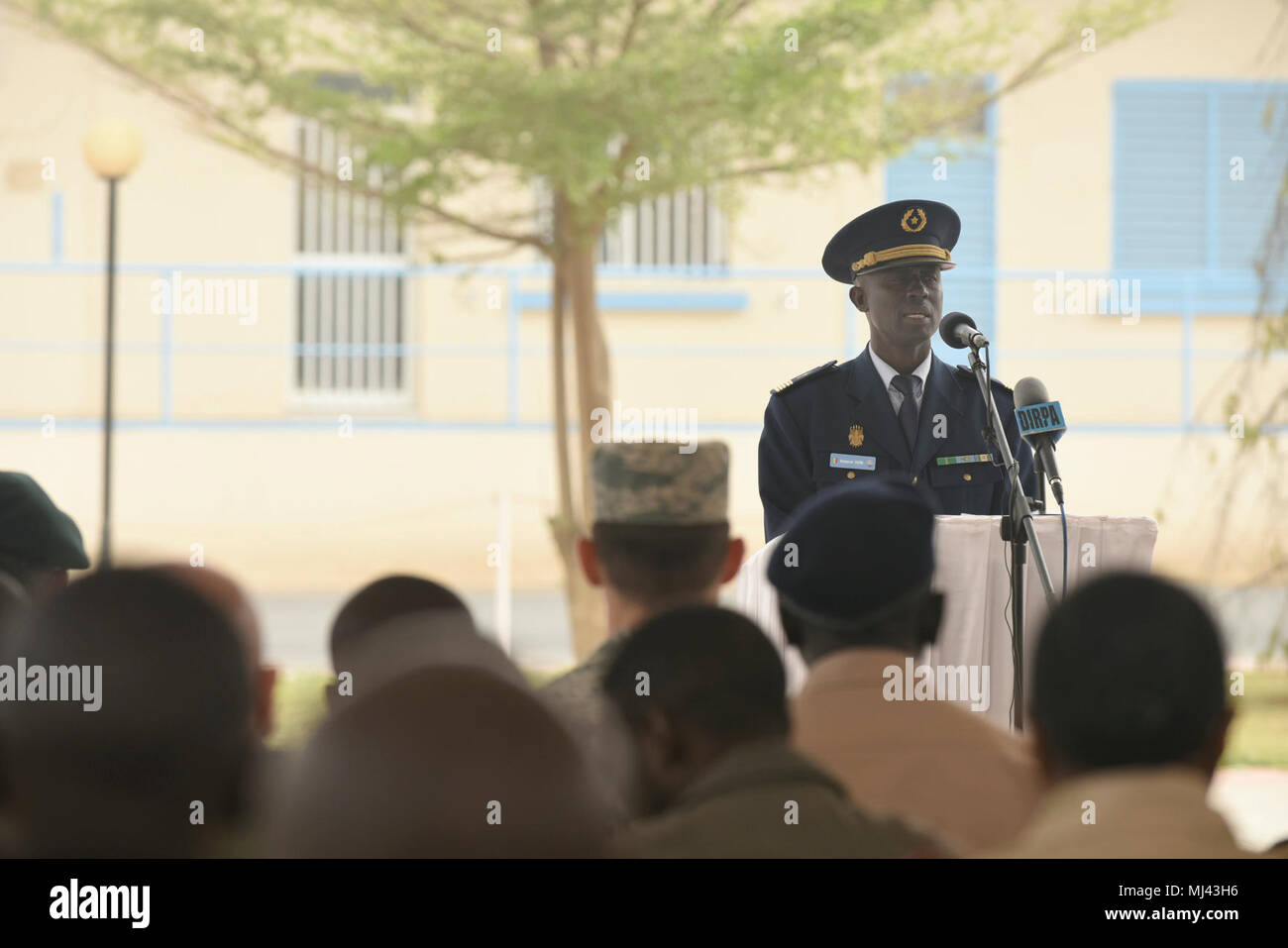 Senegalese Col. Boucar Sene, second in command of the Senegalese air force, speaks during the closing ceremony of African Partnership Flight Senegal at Captain Andalla Cissé Air Base, Senegal, March 23, 2018 The APF program is U.S. Air Forces in Africa's premier security cooperation program with African partner nations to improve professional military aviation knowledge and skills. (U.S. Air Force Image collection celebrating the bravery dedication commitment and sacrifice of U.S. Armed Forces and civilian personnel. - Stock Image