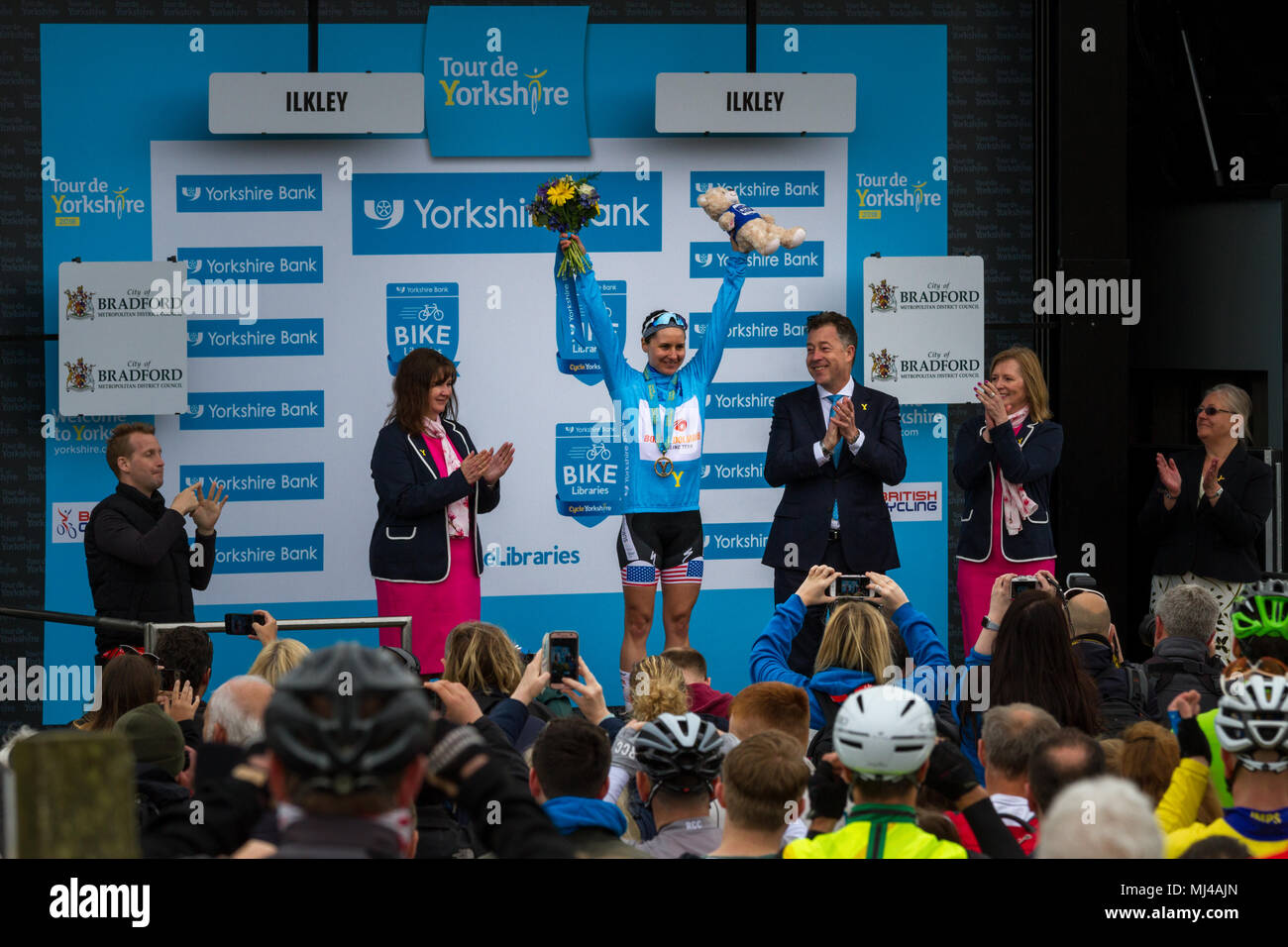 West Yorkshire, UK. 4th May 2018.  American Megan Guarnier receiving her winning blue jersey, medal, flowers and cuddly toy on the podium of the Cow and Calf Summit Finish after winning Stage Two and the overall title of the women's Tour de Yorkshire. Rebecca Cole/Alamy Live News - Stock Image