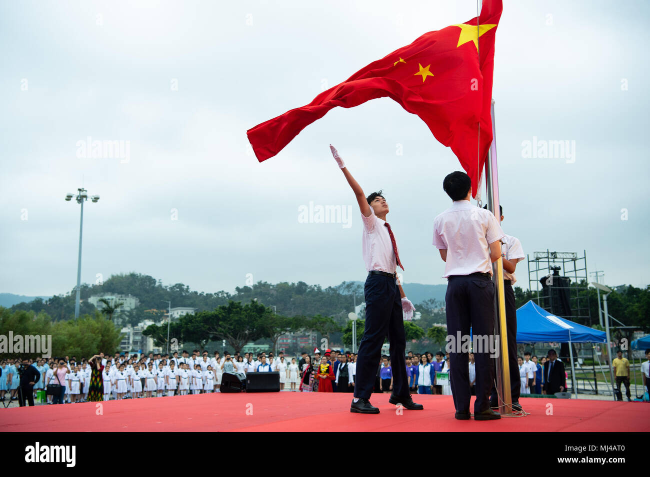 Macao. 4th May, 2018. Students of Hou Kong Middle School participate in a flag-raising ceremony marking the Chinese Youth Day in south China's Macao, May 4, 2018. Friday marked the anniversary of the May 4th Movement, a patriotic campaign that started from universities and was launched in 1919 by young Chinese to fight imperialism and feudalism. May 4th later was established as Youth Day in 1949 by the Chinese government. Credit: Cheong Kam Ka/Xinhua/Alamy Live News - Stock Image