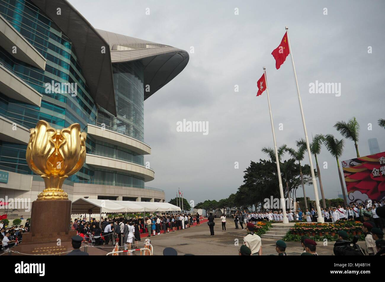 (180504) -- HONG KONG, May 4, 2018 (Xinhua) -- A flag-raising ceremony marking the Chinese Youth Day is held at the Golden Bauhinia Square in south China's Hong Kong, May 4, 2018.  Friday marked the anniversary of the May 4th Movement, a patriotic campaign that started from universities and was launched in 1919 by young Chinese to fight imperialism and feudalism. May 4th later was established as Youth Day in 1949 by the Chinese government.  (Xinhua/Wang Shen) (lmm) - Stock Image