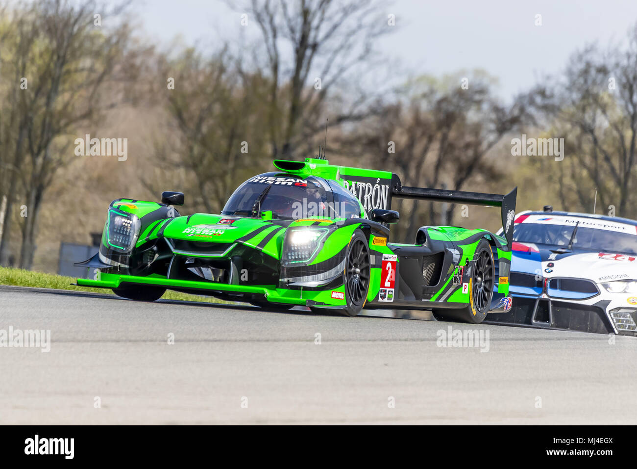 The Tequila Patron Nissan DPI Car Races Through The Turns At The Acura  Sports Car Challenge At Mid Ohio Sports Car Course Lexington, Ohio.