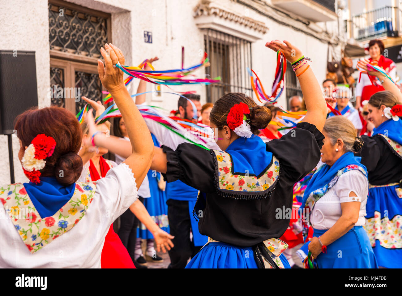 NERJA, SPAIN - MAY 04, 2018 people participating in a traditional