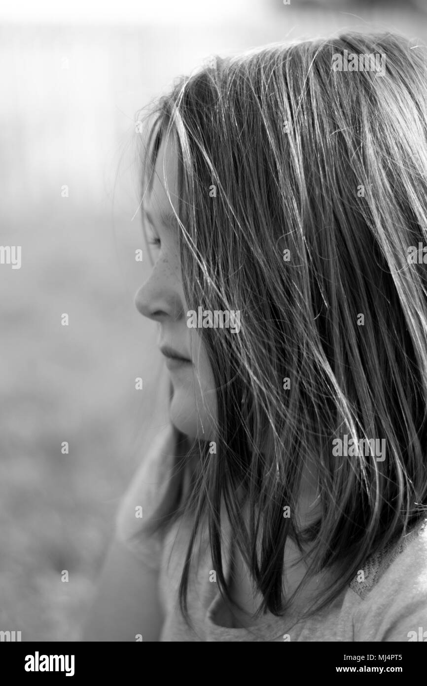 profile view of girl's face, melancholy tone - Stock Image