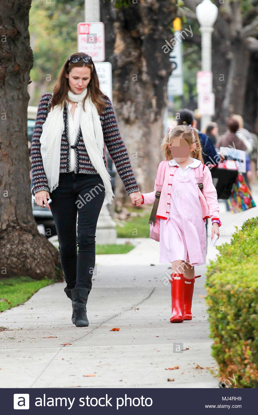 Jennifer Garner picks up her daughter Violet from school in Brentwood, CA.  Both dressed warm on a rainy day. Violet looked cute