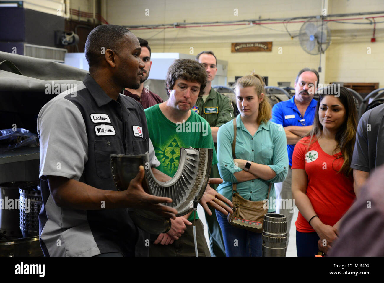 Rodney Williams, L3 Communications Propulsion Lab leadman, talks with the Mississippi State University Aircraft Propulsion Class about parts of a T-38 engine April 4, 2018, on Columbus Air Force Base, Mississippi. The majority of aircraft mechanics on Columbus are contracted through L3 Communications. (U.S. Air Force Image collection celebrating the bravery dedication commitment and sacrifice of U.S. Armed Forces and civilian personnel. - Stock Image