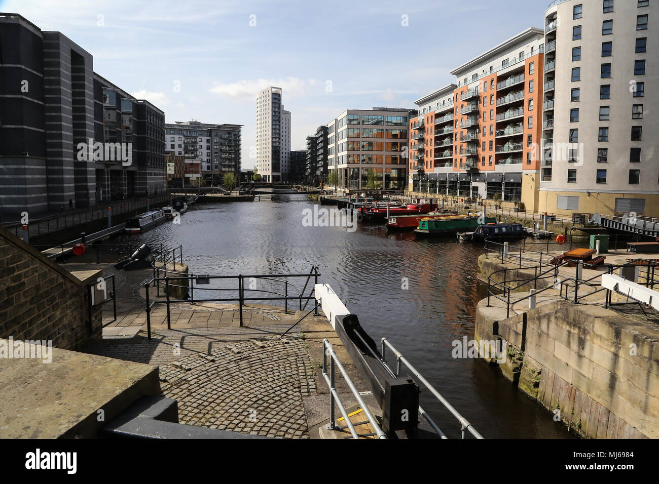 A view of Leeds Dock in the city centre formerly for boat traffic on the Leeds and Liverpool Canal. Now it is mixed use with residential and business. - Stock Image