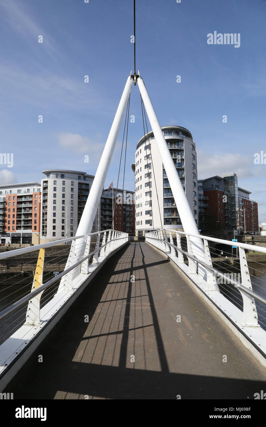 The Clarence Road Footbridge which crosses the waterways in central Leeds of the River Aire and the Leeds and Liverpool Canal at Leeds Dock. - Stock Image