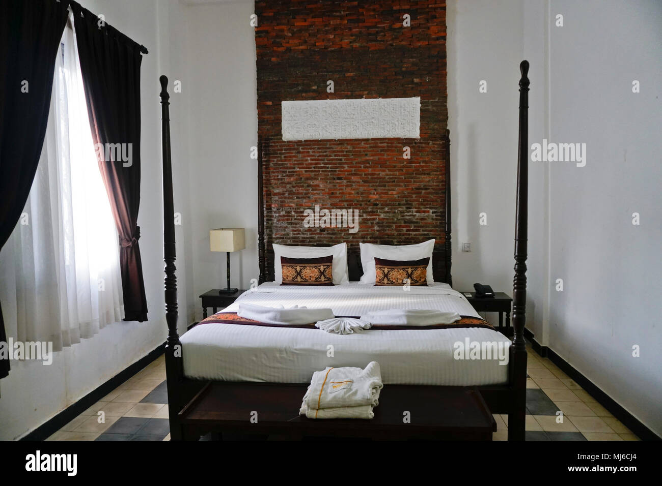Bedroom with 4 poster bed Stock Photo
