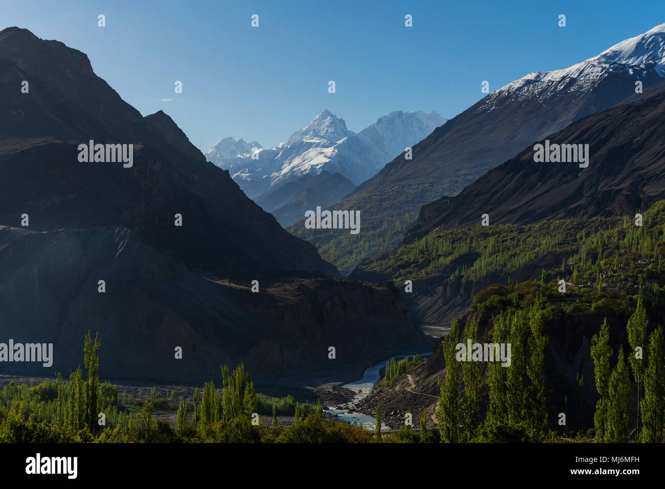 Valley mountains landscape, forest and mountain range in summer at Hunza valley Pakistan - Stock Image