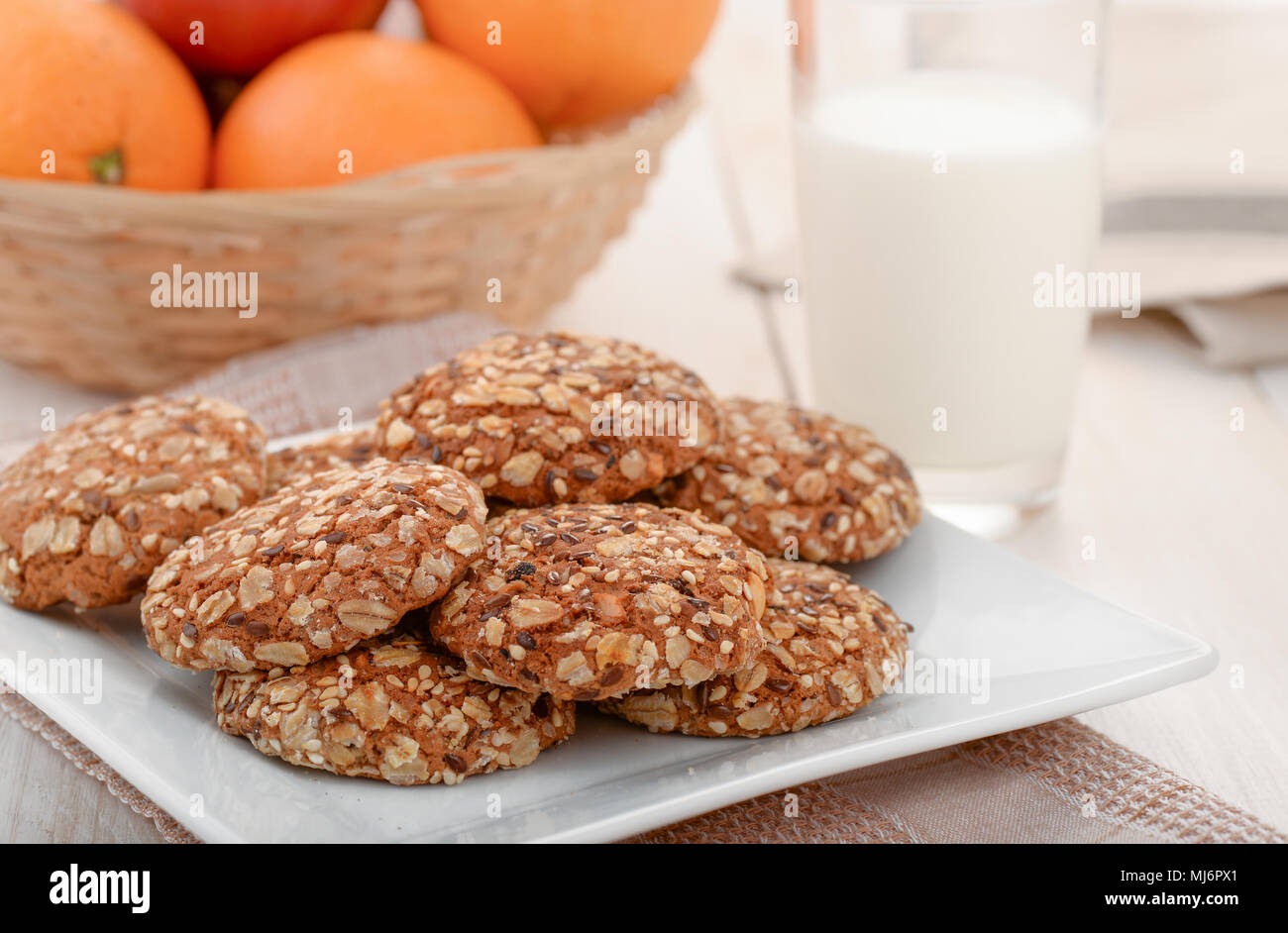 Still life with wholegrain cookies, milk and fruits - Stock Image