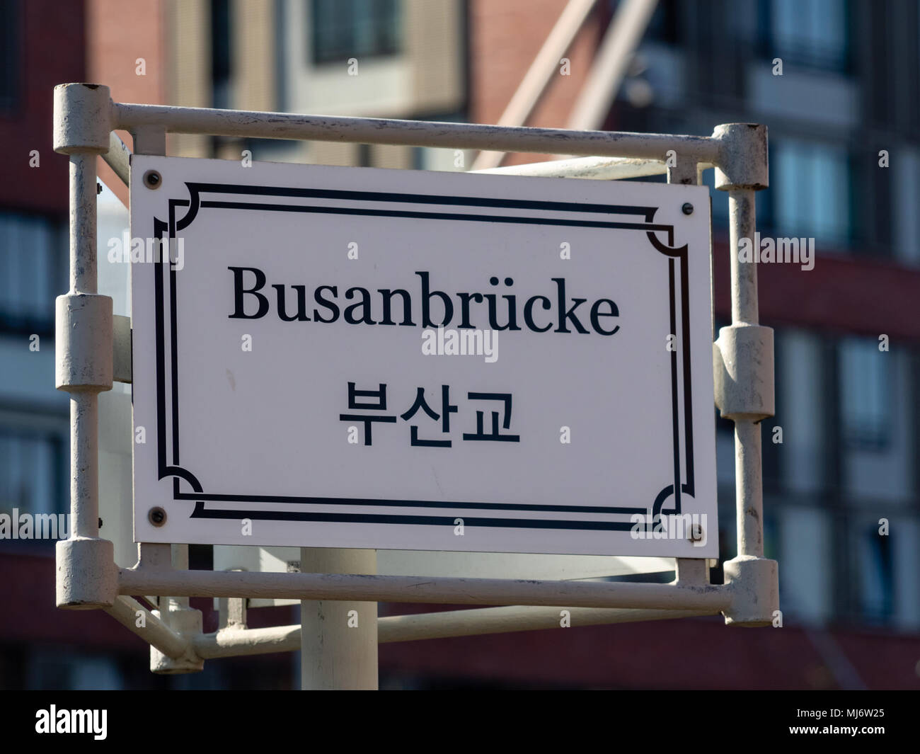Sign of Busan Bridge with german and korean letters at sunny day in Hafencity Hamburg, Germany. Selective focus. Stock Photo