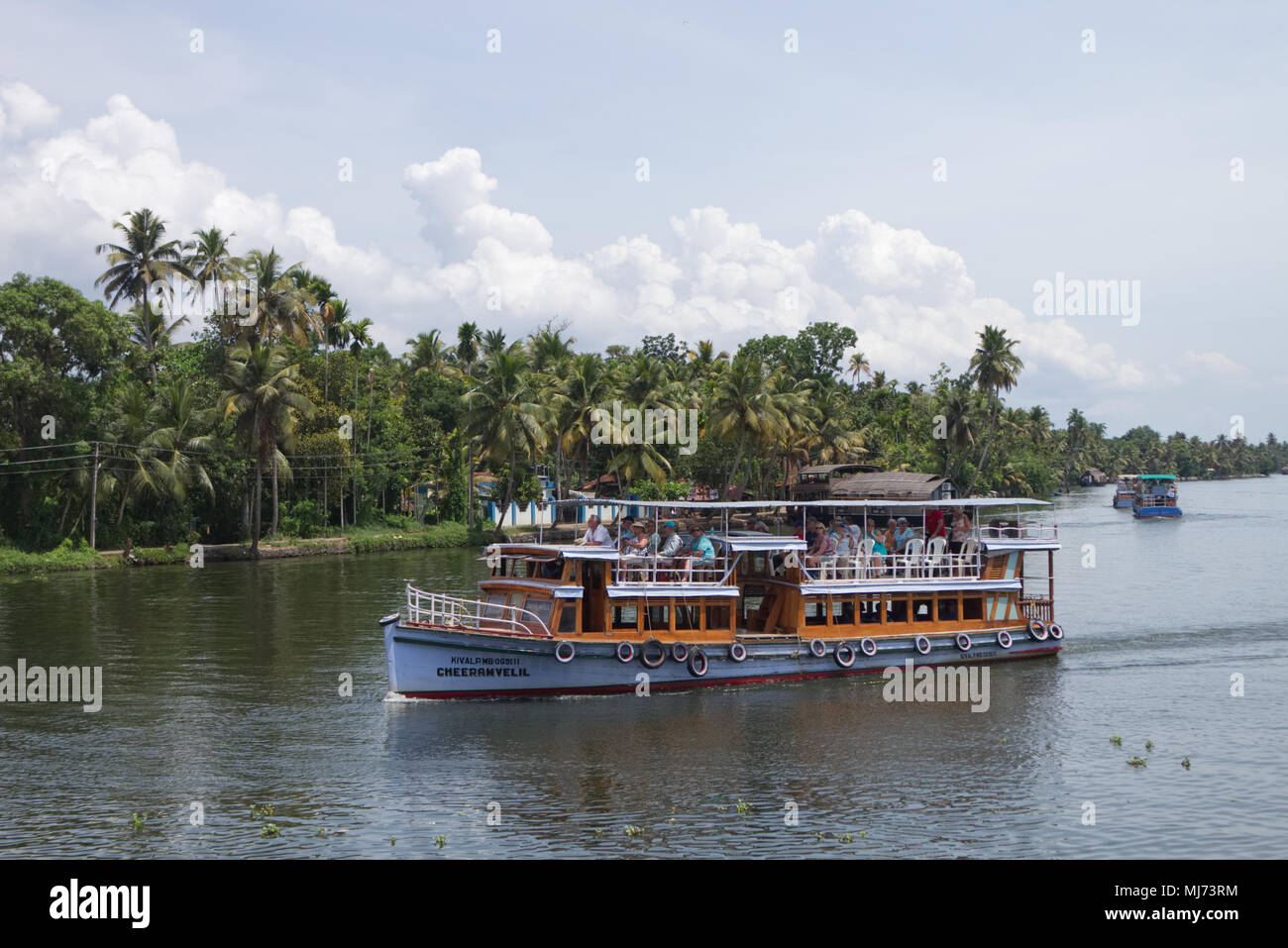 Alappuzha, Kerala / India - April 15 2018: A traditional house boat is carrying tourists on the waterways of Alappuzha. Stock Photo