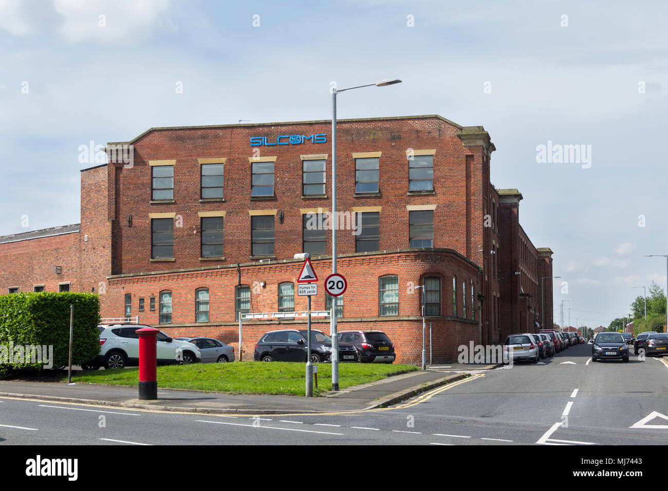 Exterior of Silcoms Ltd, Farnworth. Silcoms was established in 1939, an engineering manufacturer, specialising in the aerospace engine components. - Stock Image