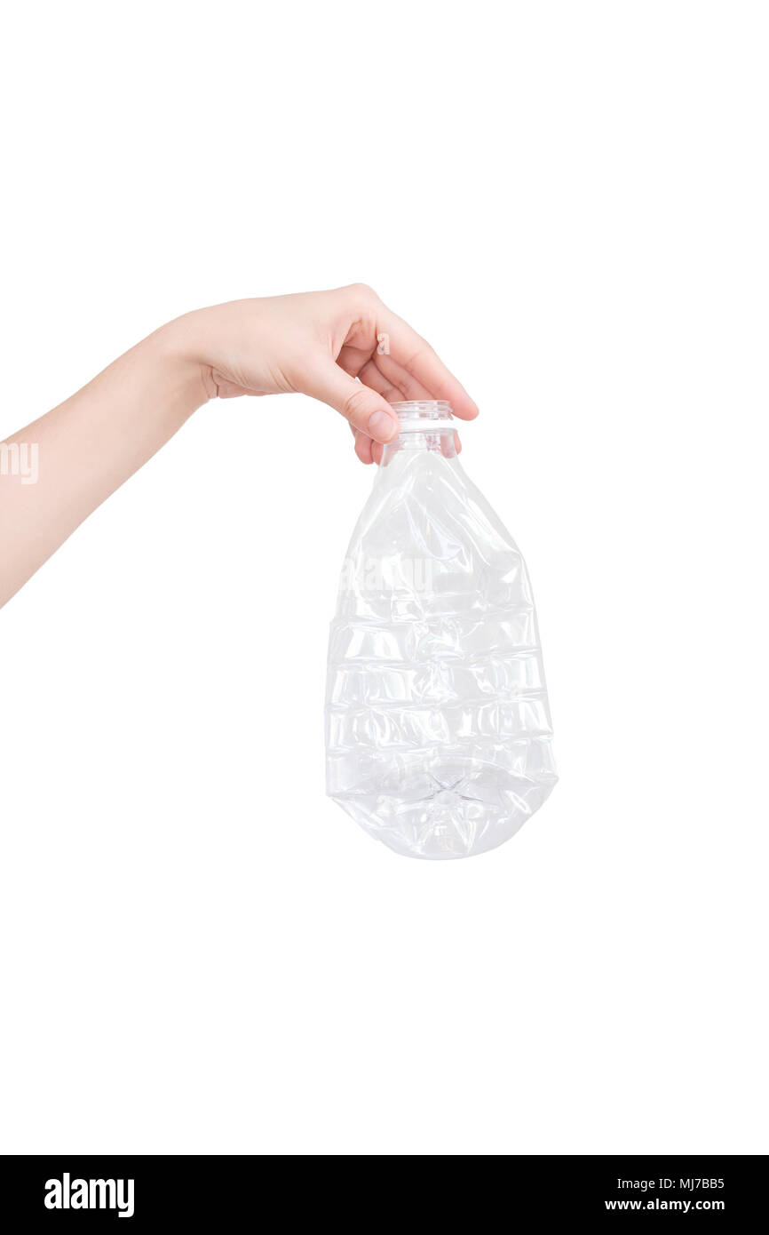 Female hand holding empty crushed plastic bottle isolated on white. Recyclable waste. Recycling, reuse, garbage disposal, resources, environment and ecology concept - Stock Image