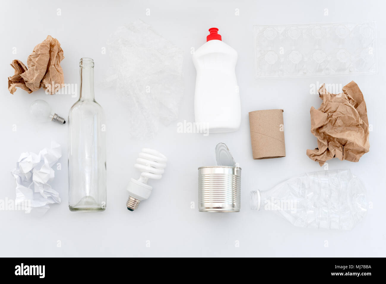 Recyclable waste, resources. Clean glass, paper, plastic and metal on white background. Recycling, reuse, garbage disposal, resources, environment and ecology concept - Stock Image