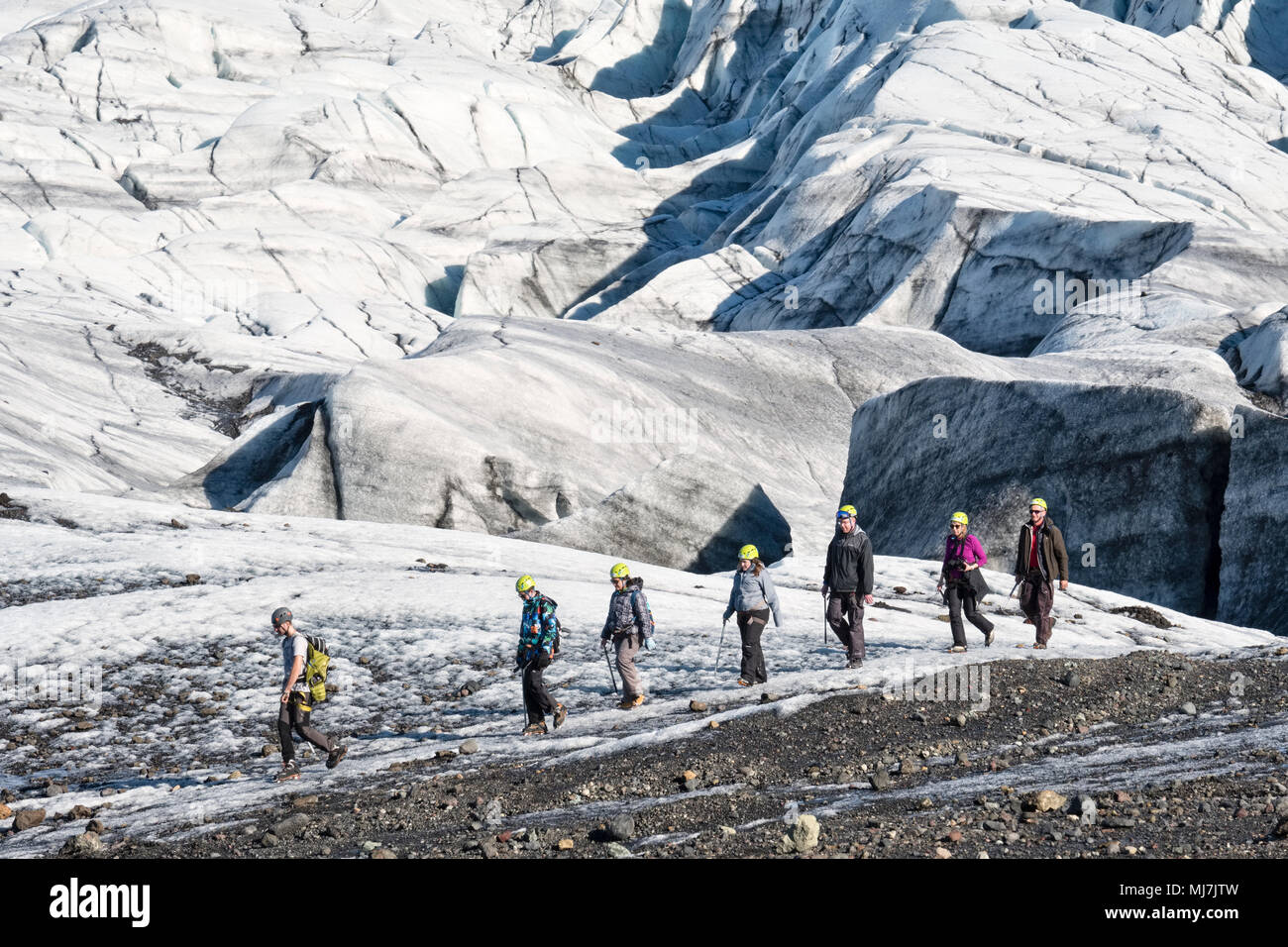 Skaftafell, Iceland. A group of tourists hiking on part of the Svínafellsjökull glacier 'tongue' - Stock Image