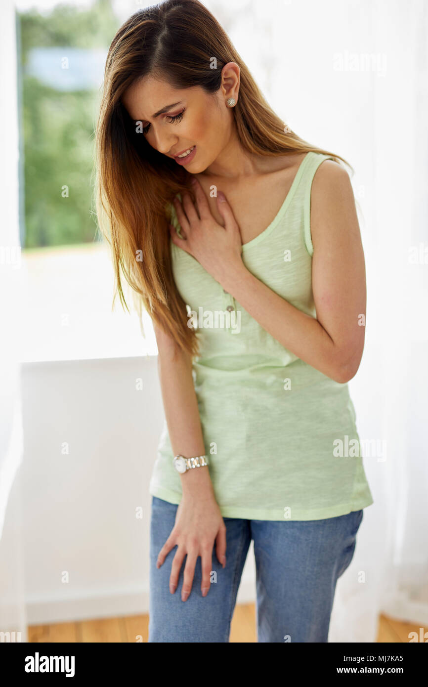 Woman with chest pain - Stock Image