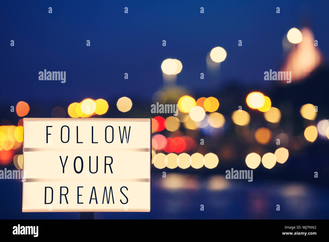 Follow Your Dreams Inspirational Life Quote Text In Lightbox City Lights Background Color Toned Picture