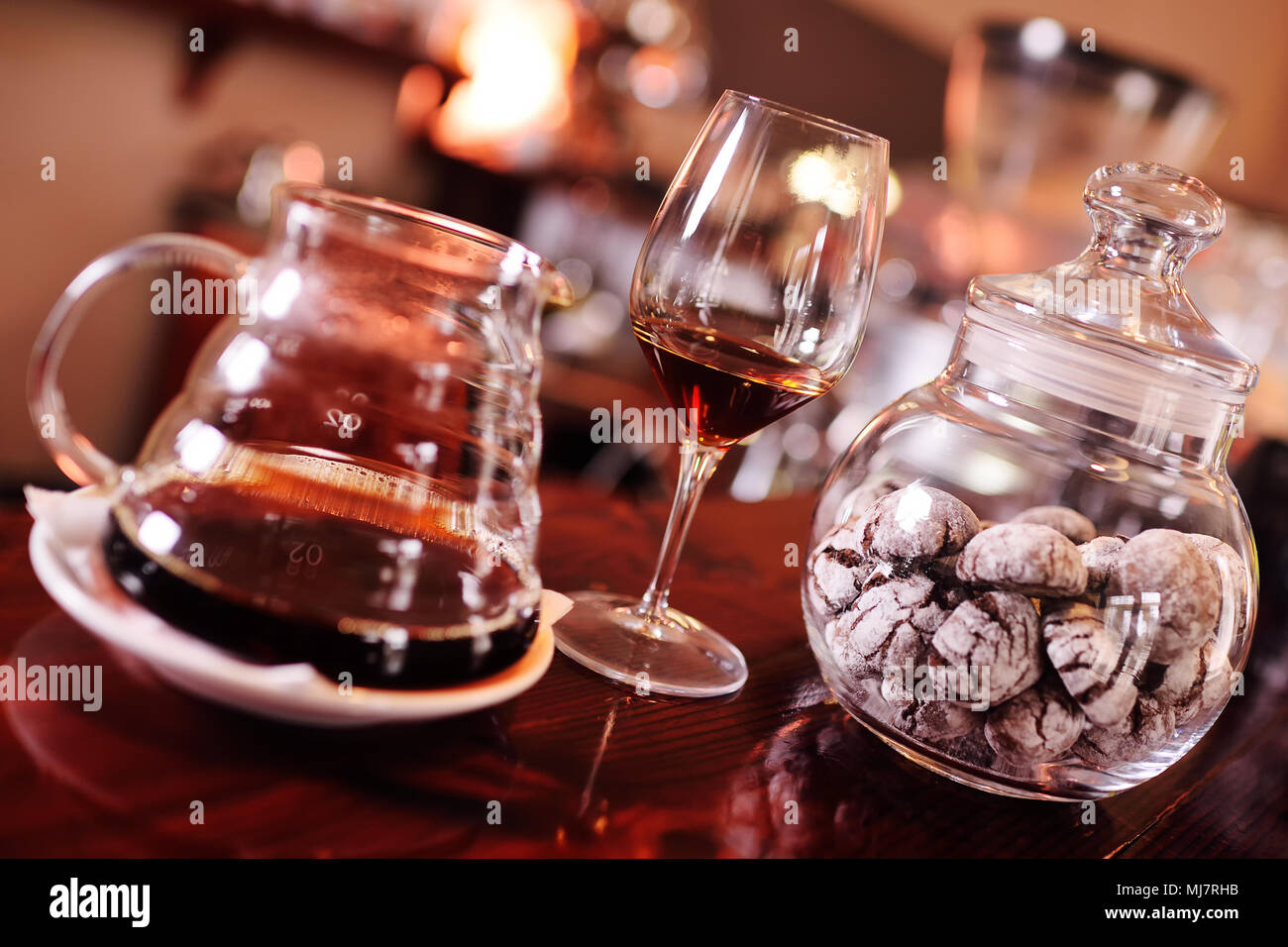 barista or coffee barman prepares coffee by an alternative method of brewing - pour over - Stock Image