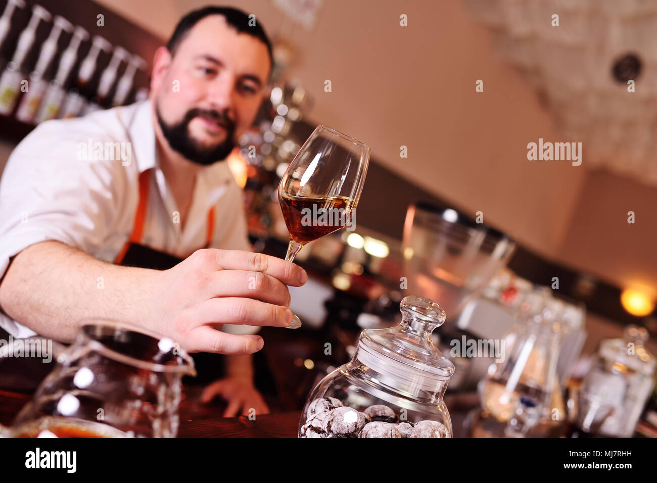 barista or coffee barman prepares coffee by an alternative method of brewing - pour over Stock Photo