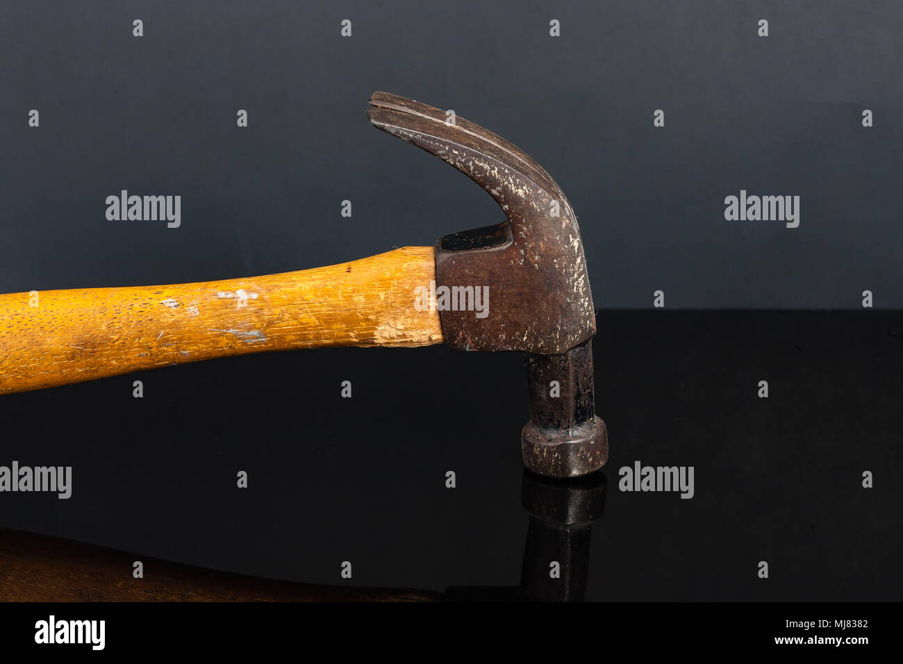 an old and heavily used carpenters claw hammer - Stock Image