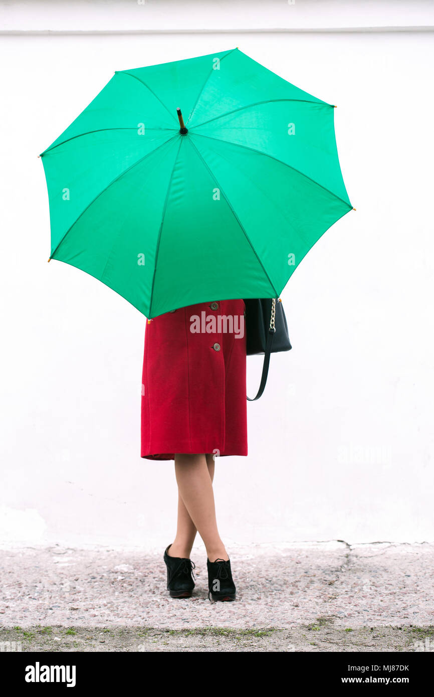 Face covered with an umbrella - Stock Image