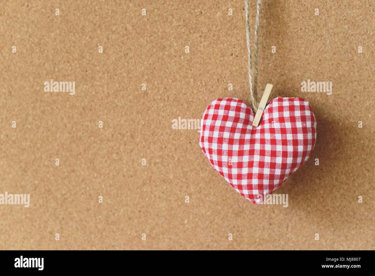 Red Textile Heart Over Brown Craft Recycle Cork Board Background