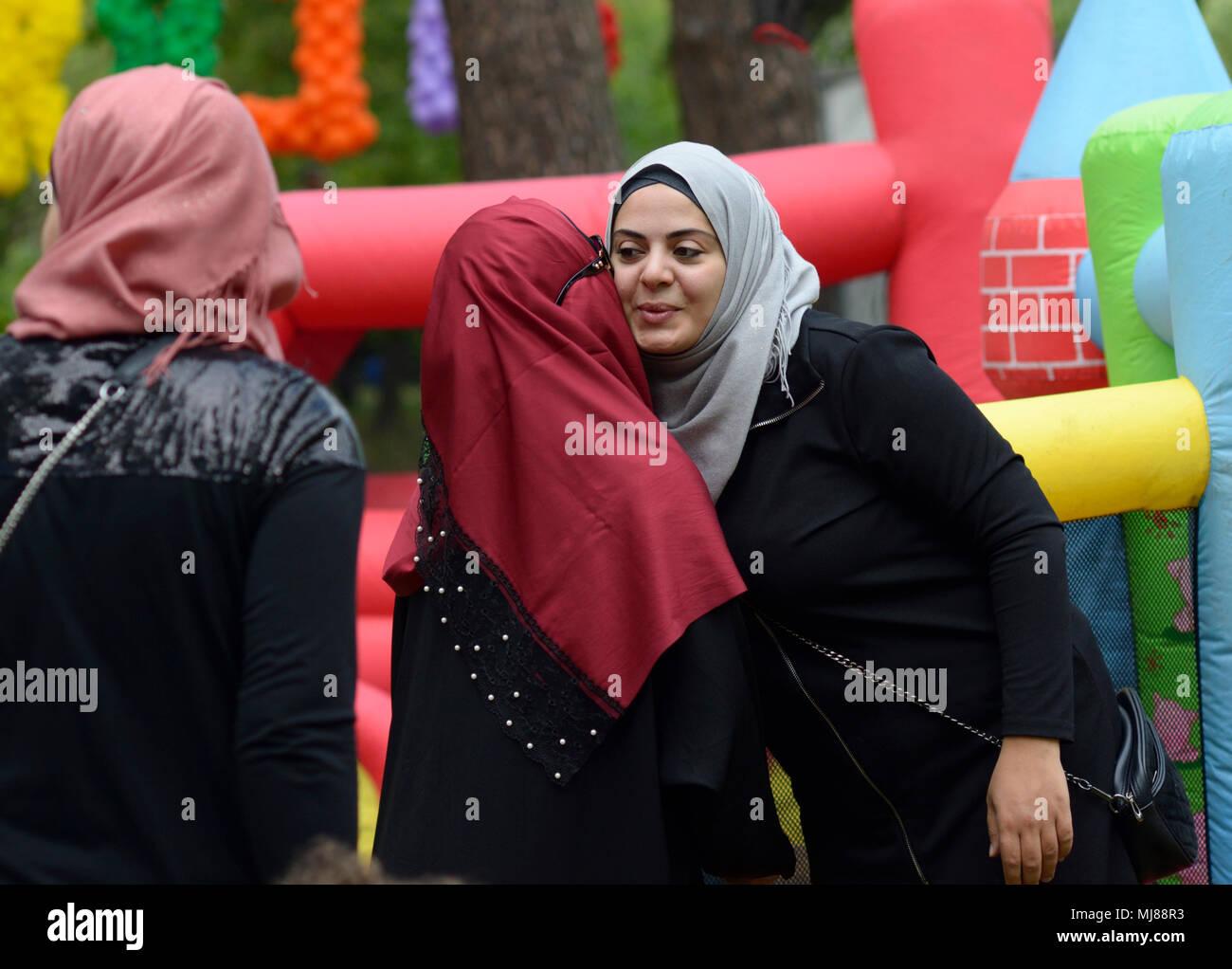 Muslim women in hijabs greeting each other during celebration of Hidirellez (festival of arrival of spring).Kiev, Ukraine - Stock Image