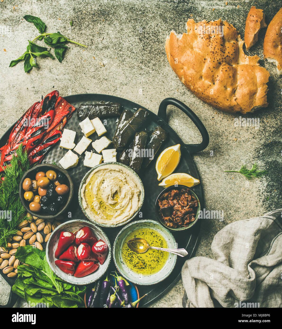 Mediterranean meze starter fingerfood platter in tray - Stock Image