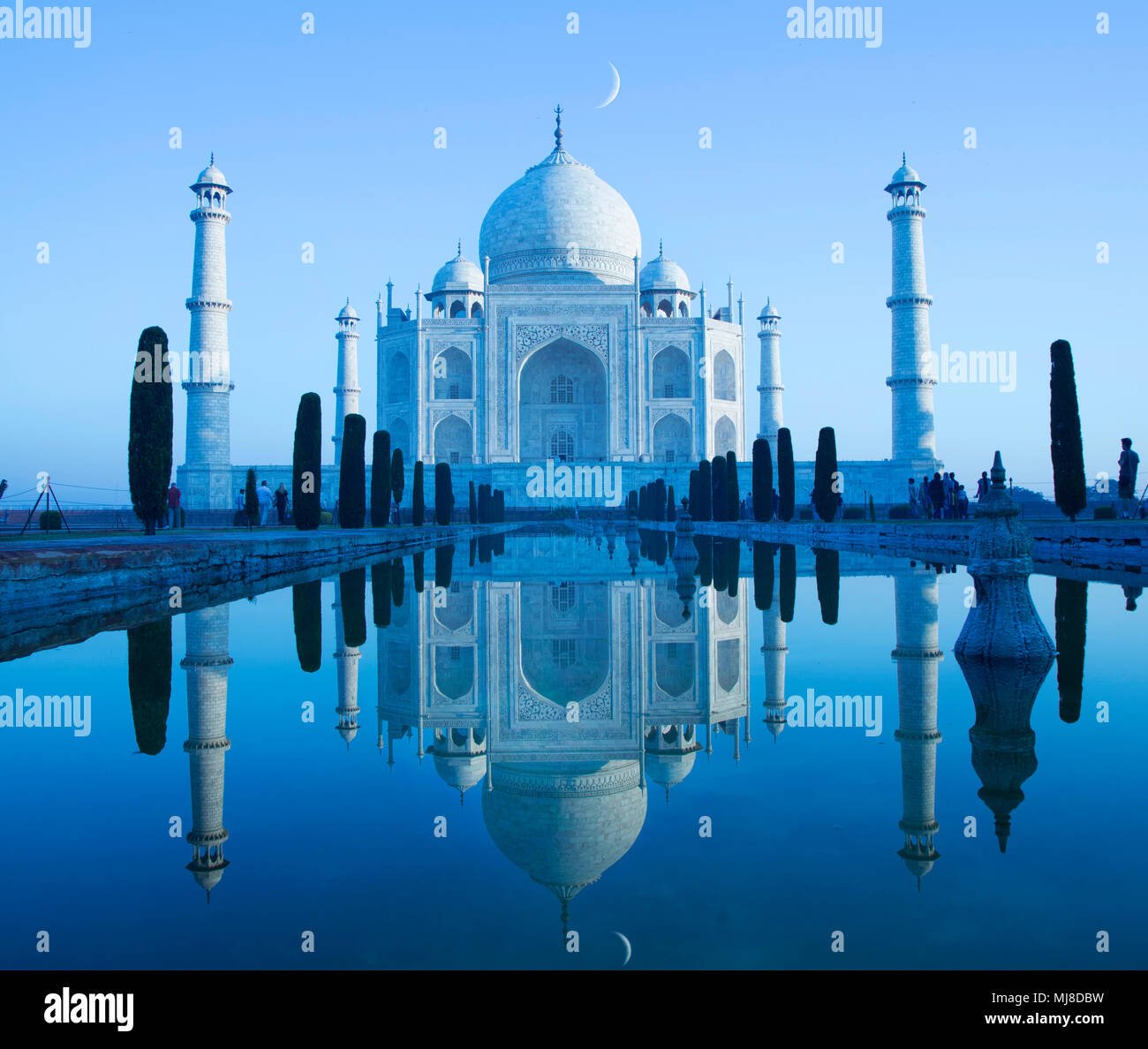 Exterior view of the Taj Mahal palace and mausoleum, a UNESCO world heritage site, a palace with white marble walls inlaid with decorative detail. - Stock Image