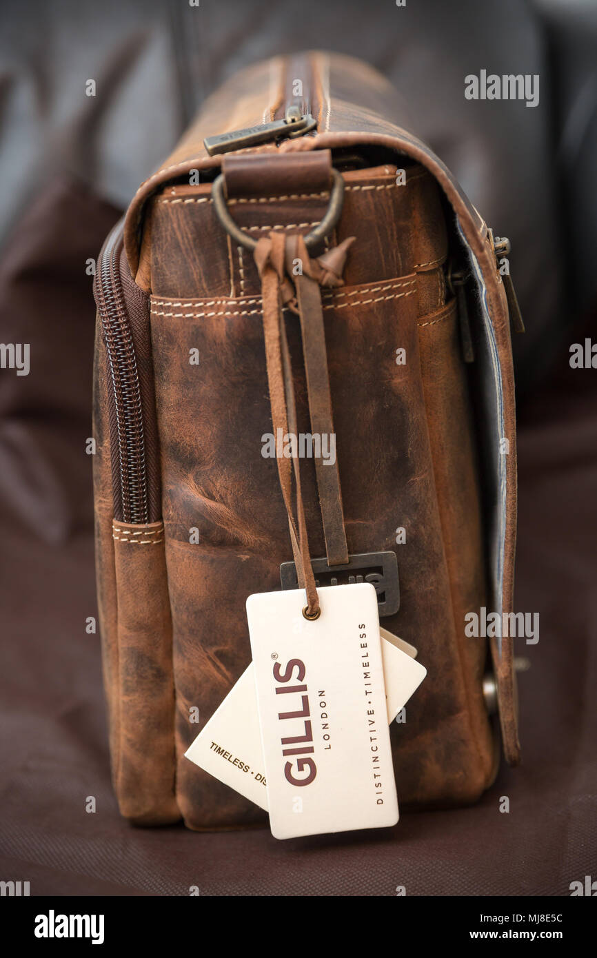 Close-up product shot of new, brown, vintage leather Gillis camera bag with tags still on. Gift ideas for the photographer in your life for Christmas. - Stock Image