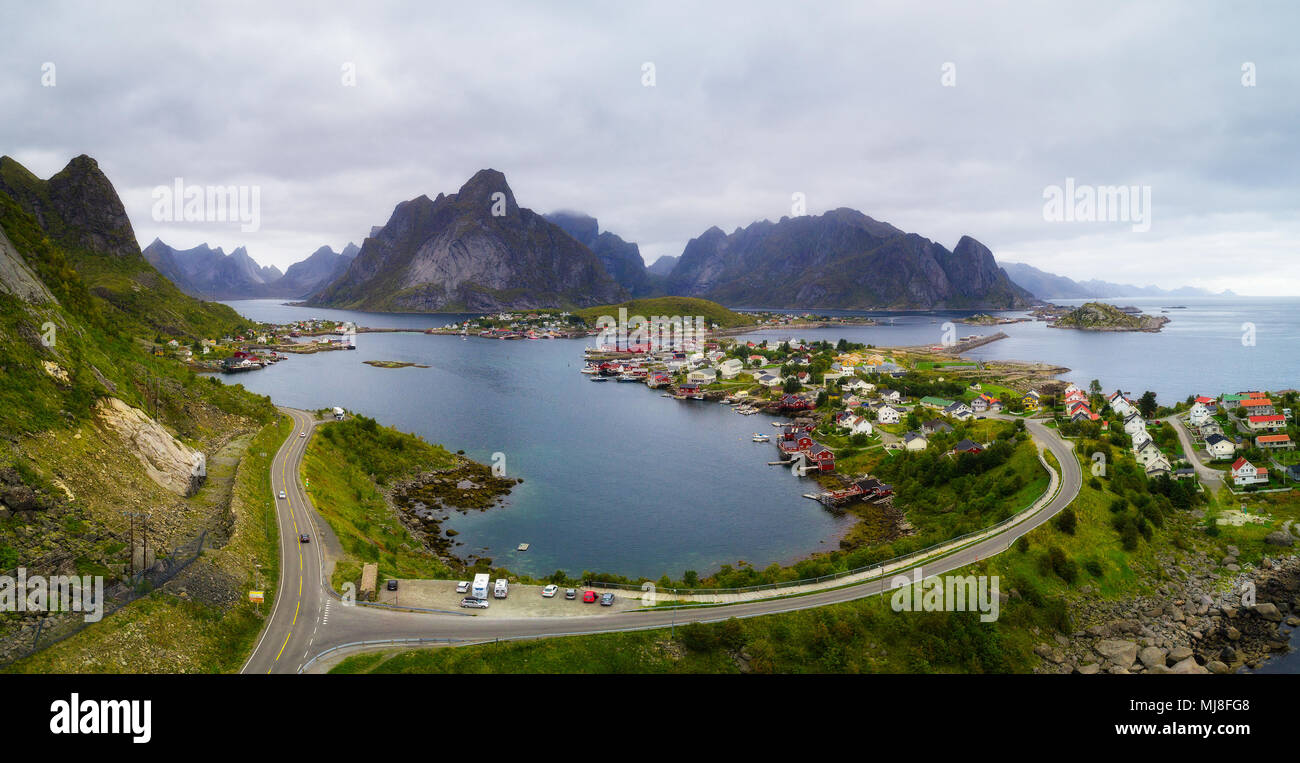 Mount Olstind and Reine fishing village on Lofoten islands - Stock Image