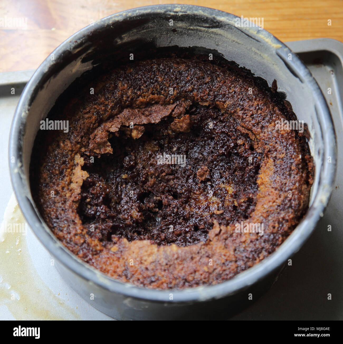 Ruined Sunken Chocolate Cake - Stock Image