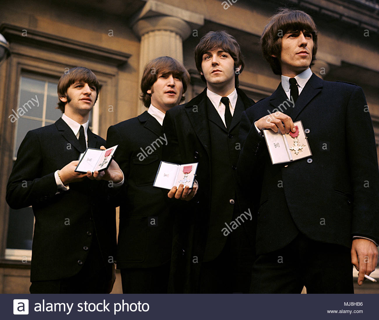 File Photo Dated 26 10 1965 Of Left To Right Ringo Starr John Lennon Paul McCartney And George Harrison The Beatles Holding Their MBEs