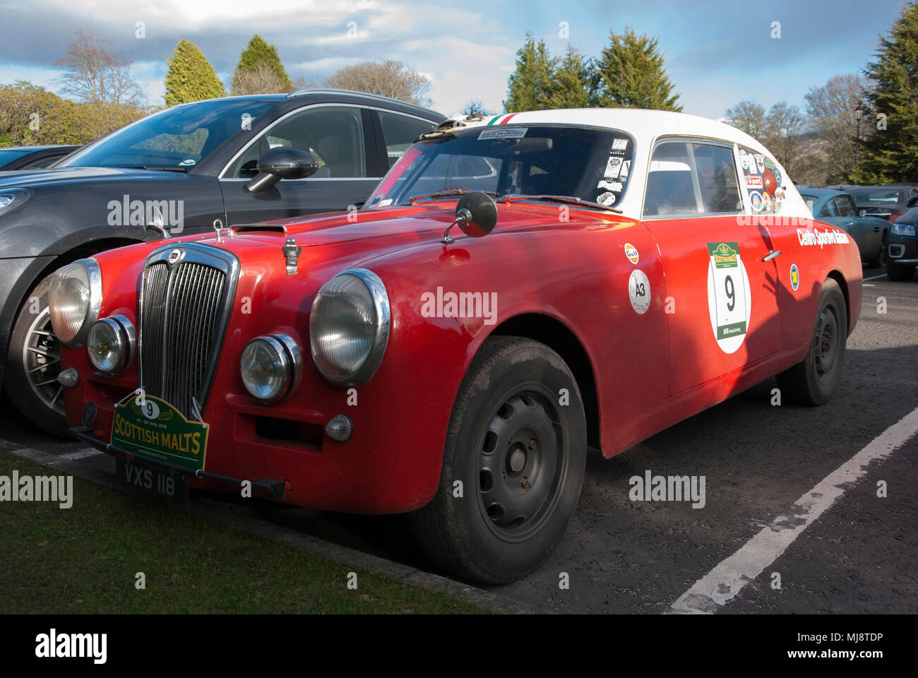 1952 Red and Cream Lancia Aurelia Classic Sports Car front nearside left hand passengers side view of 1952 red and cream lancia aurelia classic italia - Stock Image
