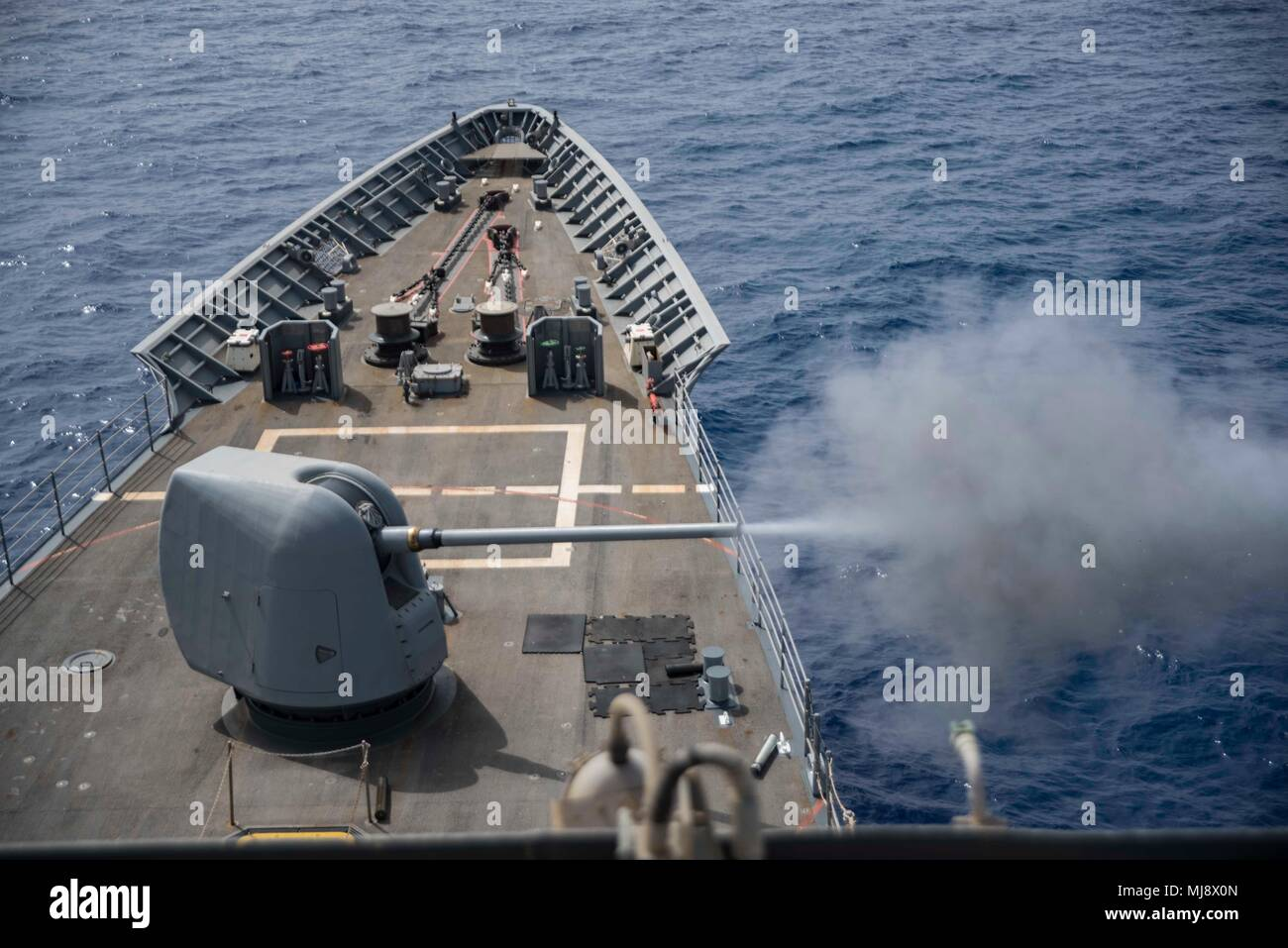 180419-N-DO281-0119  MEDITERRANEAN SEA (April 19, 2018) The guided-missile cruiser USS Monterey (CG 61) fires it's 5-inch gun during a live-fire exercise. Monterey, homeported in Norfolk, Va., and is conducting operations in the U.S. 6th Fleet area of operations in support of U.S. national security interest in Europe. (U.S. Navy photo by Mass Communication Specialist Seaman Trey Fowler/Released) Stock Photo