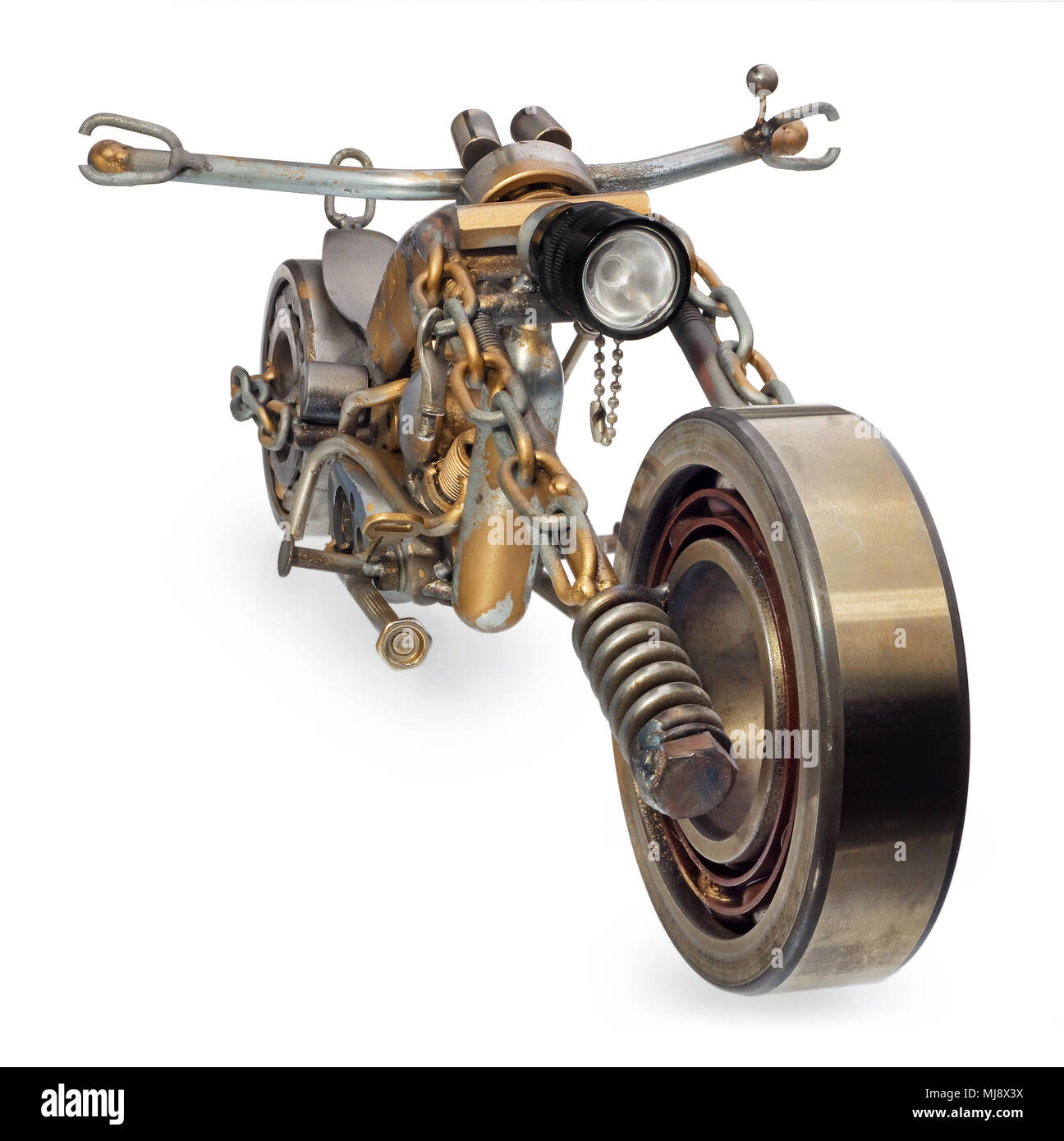 Handmade motorcycle, chopper, cruiser made of metal parts, bearings, screwdrivers, motor candles, wires, chains. A motorbike model isolated on a white - Stock Image