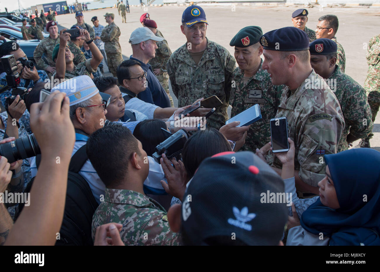 180421-N-OU129-113 TAWAU, Malaysia (April 21, 2018) Pacific Partnership 2018 (PP18) mission leaders answer media questions following the Military Sealift Command expeditionary fast transport ship USNS Brunswick's (T-EPF 6) arrival to Tawau, Malaysia. PP18's mission is to work collectively with host and partner nations to enhance regional interoperability and disaster response capabilities, increased stability and security in the region, and foster new and enduring friendships across the Indo-Pacific Region. Pacific Partnership, now in its 13th iteration, is the largest annual multinational hum - Stock Image
