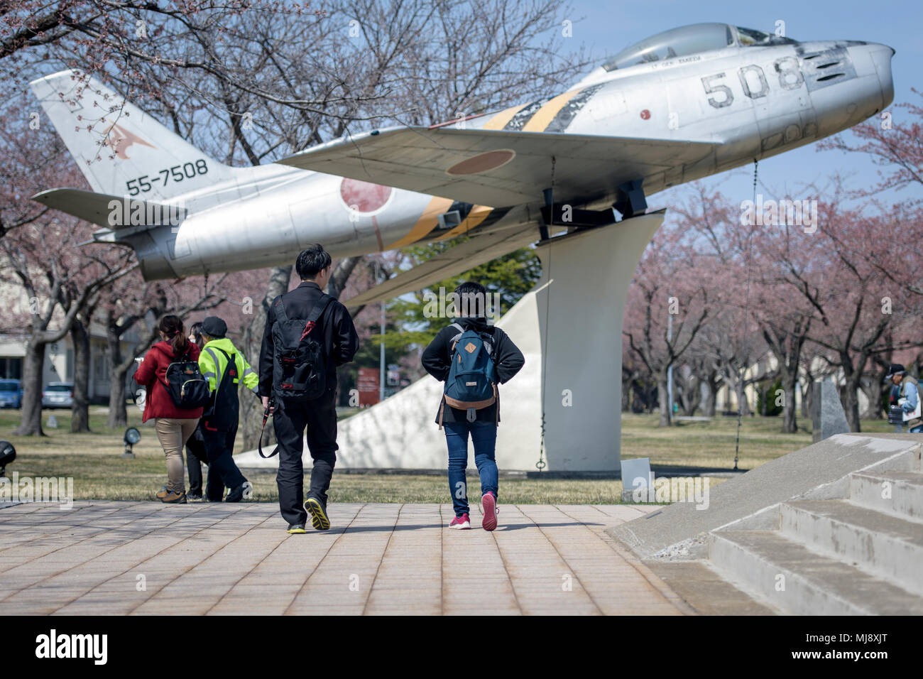 "Japanese locals participating in Misawa City's monthly Friendship Tour received a first-ever visit with the Pacific Air Forces' F-16 Demonstration Team along with the regularly scheduled windshield tour at Misawa Air Base, Japan, April 19, 2018. The Friendship Tour, previously called the Friday Tour, offers Japanese community members an opportunity to experience Team Misawa operational missions first-hand. Misawa City and Misawa Air Base began the tour nearly 20 years ago and continue working together to embrace their shared motto, ""Co-existence and Co-prosperity."" (U.S. Air Force photo by Tec - Stock Image"