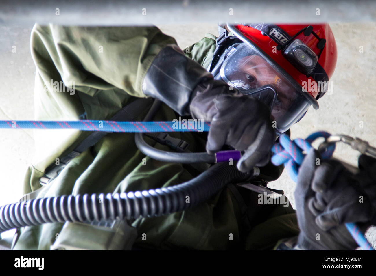 Sgt James Matter Prepares The Rappelling Apparatus To Reach A