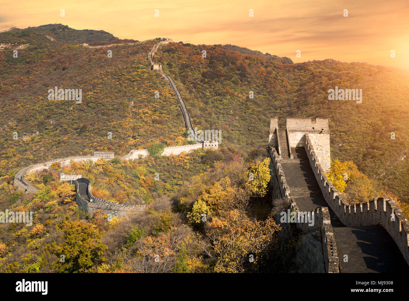 China The great wall distant view compressed towers and wall segments autumn season in mountains near Beijing ancient chinese fortification military l - Stock Image