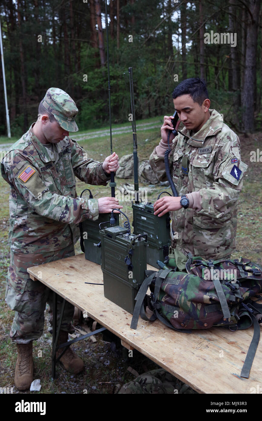 U S Army Spc Jerrod Touchton Assigned To Bravo Company 44th Expeditionary Signal Battalion 2nd Theater Signal Brigade And British Army Cpl Bibek Gurung Assigned To The 250th Signal Squadron Queen S Gurkha Signals