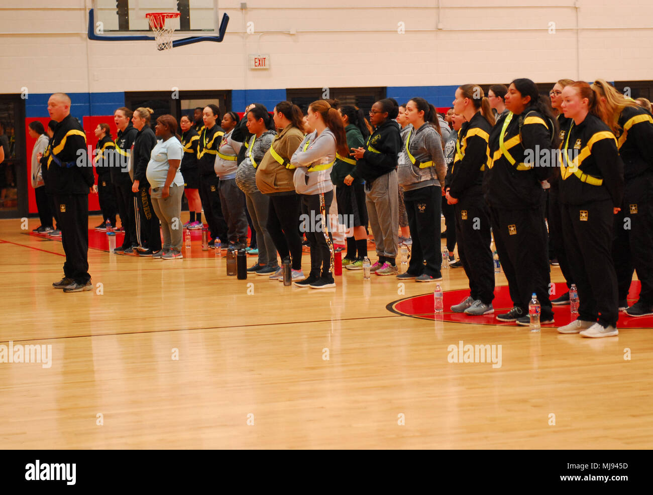 Soldiers from the 1st Cavalry Division get into formation for Army Pregnancy Postpartum Physical Training on Monday at Abrams Gym. The Army Pregnancy Postpartum Physical Training (P3T) helps female Soldiers promote bringing healthy Military children into the world, which is especially important during the Month of the Military Child. - Stock Image