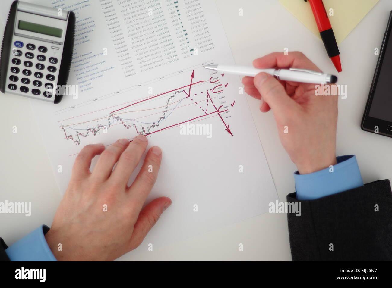 Businessman analyzing stock market - Stock Image