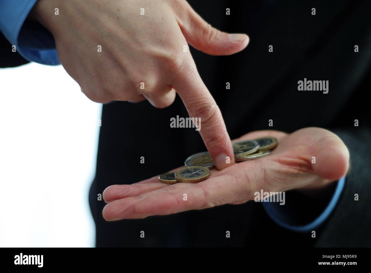 Coins in hand - Stock Image